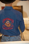 SWEETWATER, TX - MARCH 14: A Jaycees volunteer snake handler holds a western diamondback rattlesnake brought in by hunters during the 51st Annual Sweetwater Texas Rattlesnake Round-Up, March 14, 2009 in Sweetwater, Texas. Approximately 24,000 pounds of rattlesnakes will be collected, milked for venom and the meat served to support charity. (Photo by Richard Ellis)