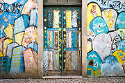 Street art on walls and door in Aveiro, Portugal