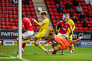 Goal line clearance from Charlton Athletic defender Chris Gunter (2) with AFC Wimbledon midfielder Jack Rudoni (12) about to battle for loose ball during the EFL Sky Bet League 1 match between Charlton Athletic and AFC Wimbledon at The Valley, London, England on 12 December 2020.