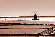 Salt pans near Ettore Infesera windmill, Masala Sicily. travel stock photos .<br /> <br /> Visit our SICILY PHOTO COLLECTIONS for more   photos  to download or buy as prints https://funkystock.photoshelter.com/gallery-collection/2b-Pictures-Images-of-Sicily-Photos-of-Sicilian-Historic-Landmark-Sites/C0000qAkj8TXCzro<br /> If you prefer to buy from our ALAMY PHOTO LIBRARY  Collection visit : https://www.alamy.com/portfolio/paul-williams-funkystock/trapanimaslalasaltpans.html .<br /> <br /> Visit our SICILY HISTORIC PLACES PHOTO COLLECTIONS for more   photos  to download or buy as prints https://funkystock.photoshelter.com/gallery-collection/2b-Pictures-Images-of-Sicily-Photos-of-Sicilian-Historic-Landmark-Sites/C0000qAkj8TXCzro<br /> .<br /> <br /> Visit our EARLY MODERN ERA HISTORICAL PLACES PHOTO COLLECTIONS for more photos to buy as wall art prints https://funkystock.photoshelter.com/gallery-collection/Modern-Era-Historic-Places-Art-Artefact-Antiquities-Picture-Images-of/C00002pOjgcLacqI