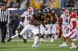 Sep 8, 2018; Morgantown, WV, USA; West Virginia Mountaineers wide receiver Dominique Maiden (82) catches a pass and runs for a touchdown during the fourth quarter against the Youngstown State Penguins at Mountaineer Field at Milan Puskar Stadium. Mandatory Credit: Ben Queen-USA TODAY Sports