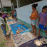Yanayacu Indian women and girls sell handicrafts to tourists visiting San Juan de Yanayacu village n Peru's Amazon Jungle.