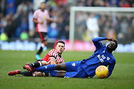 Bruno Ecuele Manga of Cardiff city is fouled by George Honeyman of Sunderland. . EFL Skybet championship match, Cardiff city v Sunderland at the Cardiff city stadium in Cardiff, South Wales on Saturday 13th January 2018.<br /> pic by Andrew Orchard, Andrew Orchard sports photography.