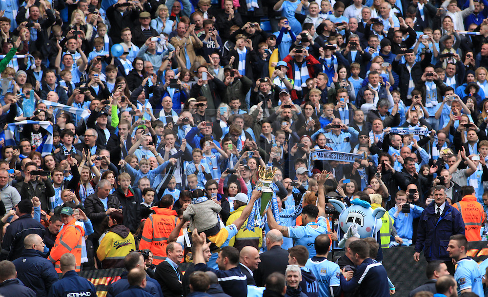 © Licensed to London News Pictures. London, UK. 11/05/2014. London, UK.  Manchester City FC celebrate after  winning of the Barclays Premier League  at the Etihad Stadium. 2013/14.Photo credit: LNP
