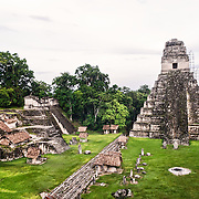 Temple 1 (also known as the Temple of the Giant Jaguar or Temple of Ah Cacao) on the Main Plaza and part of the Northern Acropolypse (at left) in the Tikal Maya ruins in northern Guatemala, now enclosed in the Tikal National Park.