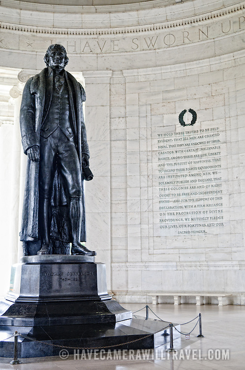 Statue inside the Jefferson Memorial rotunda with an extract from the Declaration of Independence etched into the wall in the background.