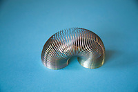 Slinky or Lazy Spring toy made of a helical spring that stretches and can bounce up and down