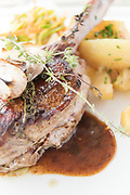 Close up of lamb dish served with potatoes in Chez Leon restaurant, Cateri, Corsica, France