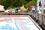USA, Alaska,Southeast,Inside Passage,Ketchikan, Creek Street Welcome Sign with historic buildings in background.