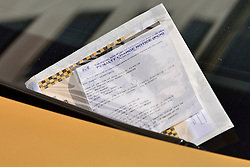 © Licensed to London News Pictures. 31/03/2016. London, UK. A parking ticket for a £350,000 Bentley covered in gold chrome wrap is parked in Knightsbridge, London on Wednesday, 31 March 2016. Cars are believed to be owned by Saudi billionaire Turki Bin Abdullah .Photo credit: Ray Tang/LNP