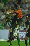 Photo Peter Spurrier<br /> 14/09/2002<br /> Spanish Premier League Football<br /> Real Betis vs Real Madrid<br /> Betis keeper, Antonio Prats Cervera, defends his goal against the threat of Madrid's Fernado Hierro during a Madrid corner.