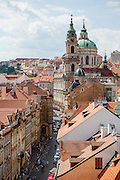 """View from a tower at the end of Charles Bridge to Mostecka street and the """"Lesser Town"""" (Mala Strana). In the back the Church of Saint Nicolas."""