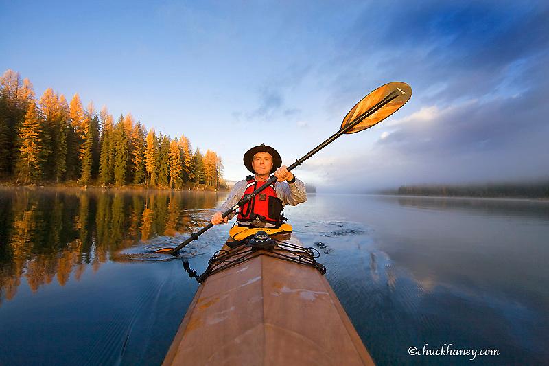 Kayaker on Lower Stillwater Lake near Whitefish Montana model released