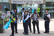 Police are seen trying to make an arrest at St Thomas' Hospital, with security personnel wearing PPE saying that the arrest needed to be done for medical reasons on Tuesday, May 5, 2020.