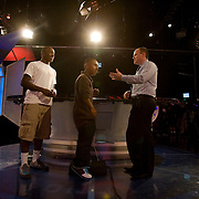 Behind the scenes as at the NFL Network. Rich Eisen shows Jonathan Pantoja and David Price (white shirt) around the main set.