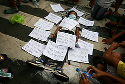 October 7, 2016 - Philippines - A young boy lies on the pavement, as his group calls for the permanent closure of a charcoal plant beside thier home in Manila. Activists from leftist group, Bayan, marched to the Mendiola Bridge in Manila, to call for changes on President Duterte's 100th day in office. (Credit Image: © J Gerard Seguia via ZUMA Wire)