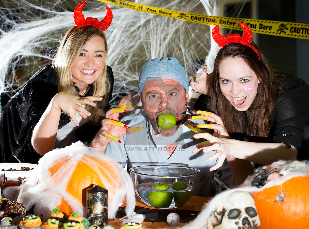 """Repro Free: 17/10/2014 <br /> """"Trick or Treat for Temple Street Halloween party""""<br /> Little Devils Evanna Kieran (left) and Cat Stewart are pictured with Dr Vamp, Eric Lawlor asking businesses all over Ireland to encourage their staff to help raise vital funds for critically ill patients by simply holding a party. Joe.ie & Her.ie invited us into their company Halloween party in aid of Temple Street. The office was transformed today and all the staff of the lifestyle website donned their costumes for a spooky coffee morning at work.<br />  <br /> Many of Temple Street's sickest kids depend on equipment bought by generous donations to stay alive. This year the hospital needs to raise over €5million to ensure that their patients receive the best care possible. Everyone loves a Halloween party – an excuse to dress up and have some fun in work with your colleagues. But these Halloween parties can truly mean the difference between life and death. <br />  <br /> To sign your business up to 'Trick or Treat for Temple Street' please visit www.templestreet.ie Picture Andres Poveda<br />  <br /> -ENDS-<br />  For more information please contact Annette Small, Communications Manager, 01 878 4638/<br /> 0860294183"""