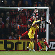 AFC Bournemouth defender Tommy Elphick heads clear during the Capital One Cup match between Bournemouth and Liverpool at the Goldsands Stadium, Bournemouth, England on 17 December 2014.