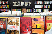 A woman browses through the foreign book section od a Shanghai bookstore. China's state media said recently that nearly half of the media products such as books, films, music CDs and software bought by Chinese consumers in 2005 were pirated.