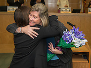 Westside High School principal Marguerite Stewart, right, hugs Employee of the Month Helen Tran during a Houston ISD Board of Education meeting, December 12, 2013.