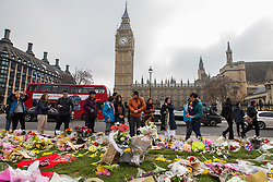 © Licensed to London News Pictures . 27/03/2017 . London , UK . Flowers and tributes in Parliament Square opposite Parliament in Westminster , in response to Khalid Masood's terrorist attack and the killing of PC Keith Palmer . Photo credit: Joel Goodman/LNP