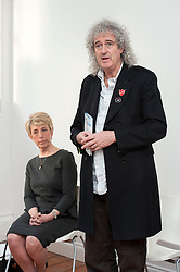 © Licensed to London News Pictures.  25/03/2015. Stroud, Gloucestershire, UK.  Angela Smith and Brian May.  Brian May holds a meeting at Lansdown Hall as part of his Common Decency tour on getting common decency back into politics, with Angela Smith, the Labour Shadow DEFRA Minister, and David Drew, Labour PPC for Stroud.  All three speakers also spoke against the badger cull which has taken place in parts of Gloucestershire for the last two years.  Photo credit : Simon Chapman/LNP