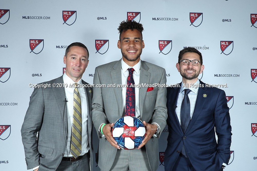 CHICAGO, IL - JANUARY 11: JJ Williams was taken with the eighteenth overall pick by Columbus Crew SC. With head coach Caleb Porter (left) and team president Tim Bezbatchenko (right). The MLS SuperDraft 2019 presented by adidas was held on January 11, 2019 at McCormick Place in Chicago, IL.