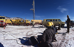 Stock photo of men working in the snow at a CO2 fracking site