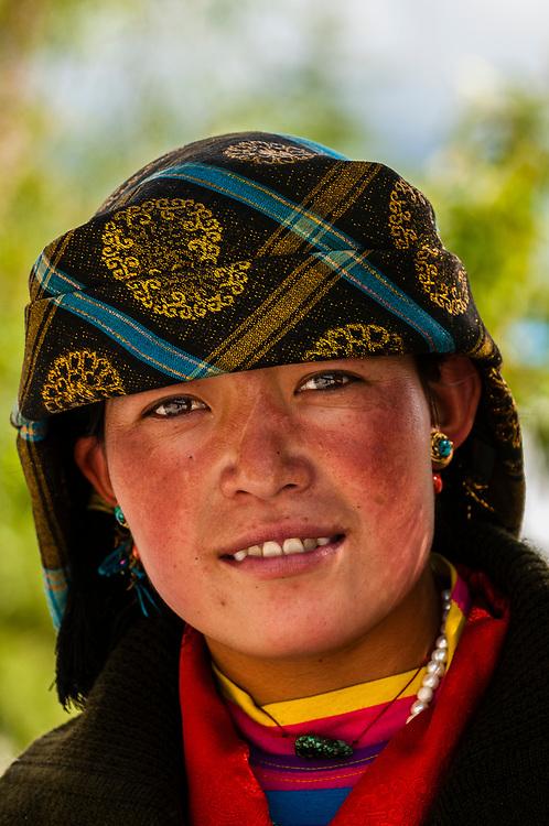 Woman wearing traditional dress from Shigatse, outside the Sera Monastery, outside Lhasa, Tibet (Xizang), China.