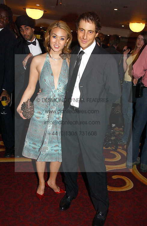 BRUCE WILPON and his wife YUKI OSHIMA-WILPON , he is the son of Fred Wilpon, the New York multimillionaire real-estate developer who the New York Mets baseball team at the 10th Anniversary Asian Business Awards 2006 at the London Grosvenor Hotel Park Lane, London on 19th April 2006.<br /><br />NON EXCLUSIVE - WORLD RIGHTS