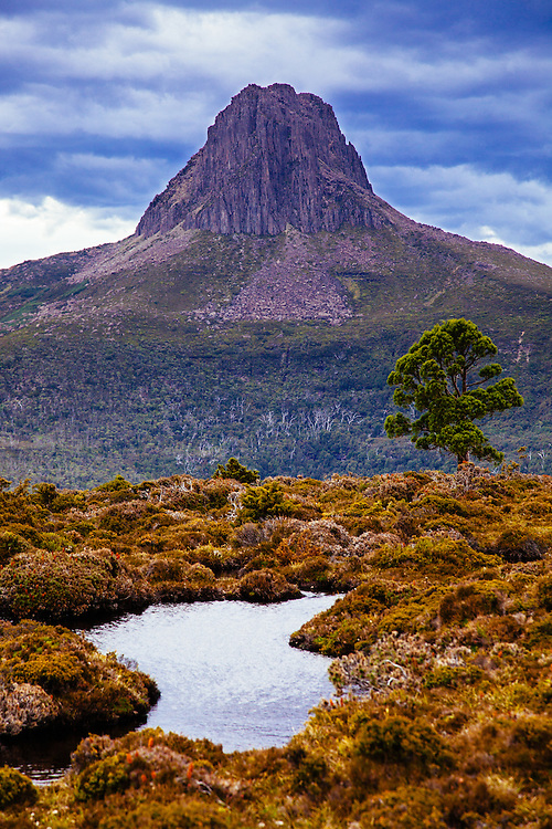 Summer storm clouds gather to the west of the prominent dolerite peak Barn Bluff in Cradle Mountain - Lake St Clair National Park.
