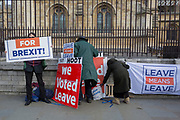 Brexiteers protest with home-made placards outside Parliament,  on 11th March 2019, in Westminster, London, England.