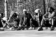"""April 17th 2005. New York, New York. United States..Located in the heart of Greenwich Village, the West 4th Street basketball Court, known as """"The Cage"""", offers no seating but attracts the best players and a lot of spectators as soon as spring is around the corner..Half the size of a regular basketball court, it creates a fast, high level of play. The more people watch, the more intense the games get. « The Cage » is a free show. Amazing actions, insults and fights sometimes, create tensions among and inside the teams. The strongest impose their rules. Charisma is present..""""The Cage"""" is a microcosm. It's a meeting point for the African American street culture of New York. Often originally from Jamaica or other islands of the Caribbean, they hang out, talk, joke, laugh, comment the game, smoke… Whether they play or not, they're here, inside """"The Cage"""". Everybody knows everybody, they all greet each other, they shake hands and hug: """"Yo, whasup man?"""""""