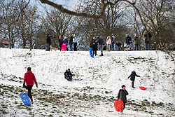 © Licensed to London News Pictures. 28/02/2018. London, UK. Sledgers in Greenwich Park following heavy snowfall and sub zero temperatures overnight. The cold weather originating in Siberia has been dubbed 'the Beast from the East'.  Photo credit : Tom Nicholson/LNP