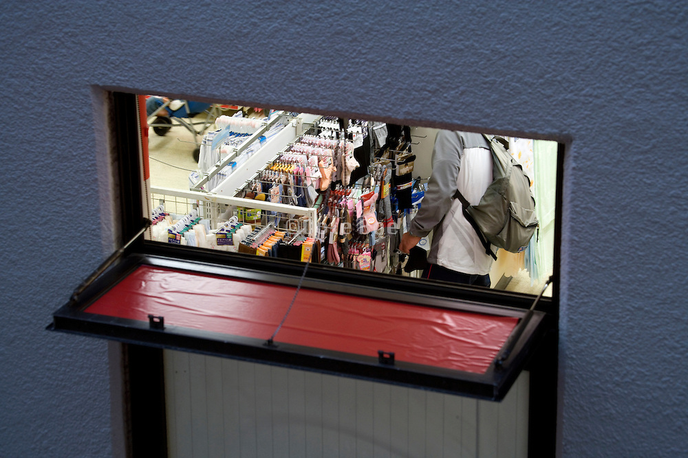inside of discount store seen from small window