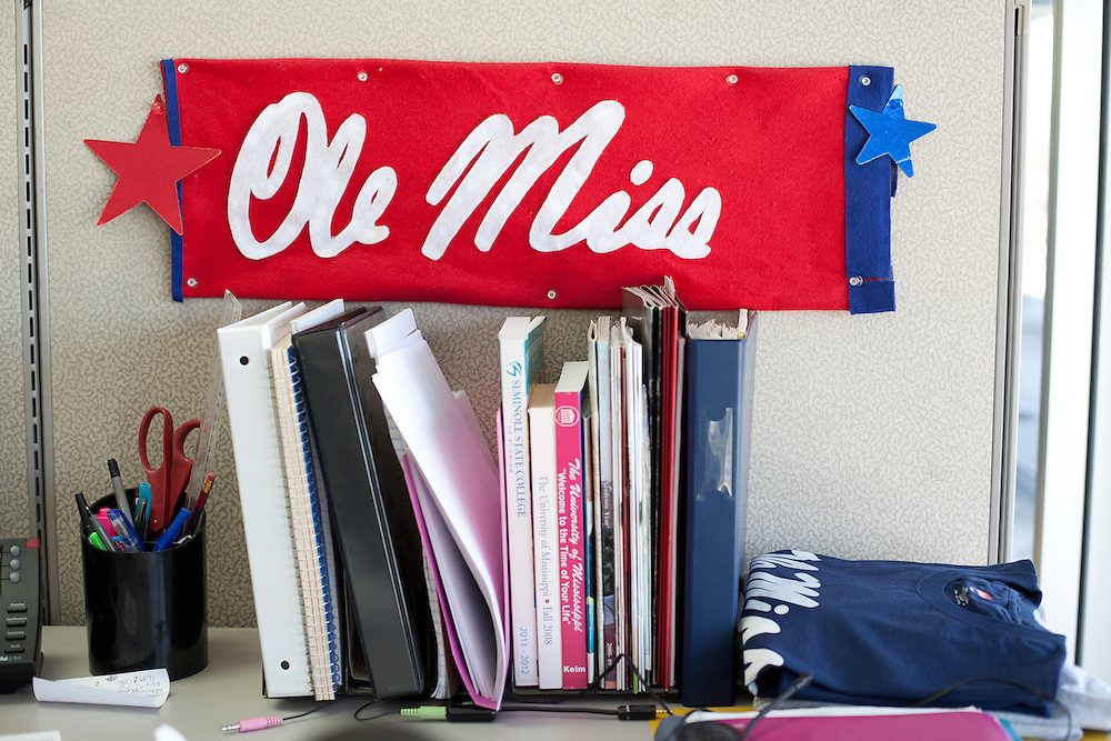"""Carrie Benavides has supported callers from Ole Miss for three years and now decorates her office with flags and banners. """"I've become kind of a fan,"""" says Benavides of the university's storied football team."""