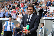 Antonio Conte, the Chelsea manager wets his hands as he looks on from the dugout ahead of k/o. Premier league match, Swansea city v Chelsea at the Liberty Stadium in Swansea, South Wales on Sunday 11th Sept 2016.<br /> pic by  Andrew Orchard, Andrew Orchard sports photography.