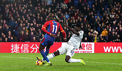 Crystal Palace's Wilfried Zaha (left) and Cardiff City's Bruno Ecuele Manga (right) battle for the ball during the Premier League match at Selhurst Park, London.
