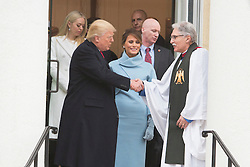 President-elect of The United States Donald J. Trump and First lady-elect Melania Trump chat with Rev. Luis Leon while departing St. John's Church in Washington, DC, shortly before he will be inaugurated as the 45th President of The United States, January 20, 2017. Credit: Chris Kleponis / EPA