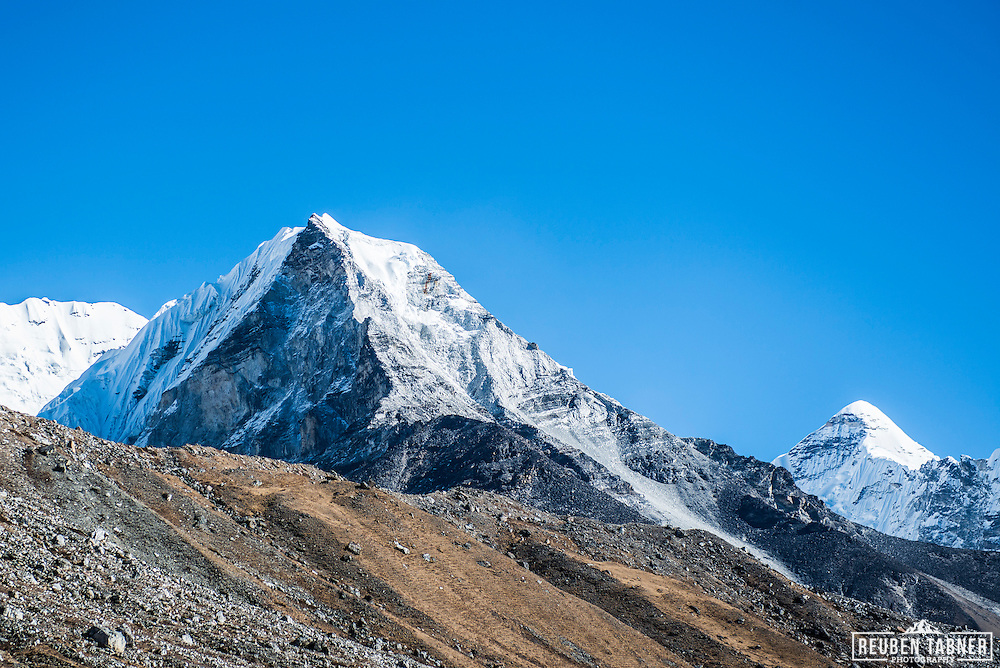 Island Peak, 6189 meters rises from behind the moraine wall of the Lhotse Glacier.