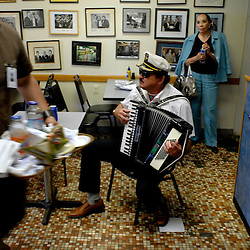 """Native Baltimorean George Starka plays the accordian in the """"Kibbitz Room"""" during a lunchtime stop at Attman's New York Delicatessen.  """"You never know who's going to show up here,"""" stated long-time manager Earl Oppel.  ..Photo by Susana Raab"""