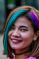 A Cambodian woman with colorful hair at The Baphuon, a temple at Angkor, Cambodia. It is located in Angkor Thom, northwest of the Bayon. Built in the mid-11th century, it is a three-tiered temple mountain built as the state temple of Udayadityavarman II dedicated to the Hindu God Shiva.