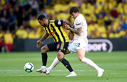 Watford's Andre Gray (left) and Manchester United's Victor Lindelof battle for the ball