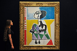 """© Licensed to London News Pictures. 15/06/2017. London, UK. A staff member views """"Femme accroupie"""", 1954, by Pablo Picasso (estimate GBP6.5-8.5m).  Preview of Impressionist and Modern art sale, which will take place at Sotheby's New Bond Street on 21 June.  Photo credit : Stephen Chung/LNP"""