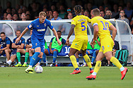 AFC Wimbledon striker Joe Pigott (39) dribbling and taking on Wycombe Wanderers defender Anthony Stewart (5) during the EFL Sky Bet League 1 match between AFC Wimbledon and Wycombe Wanderers at the Cherry Red Records Stadium, Kingston, England on 31 August 2019.