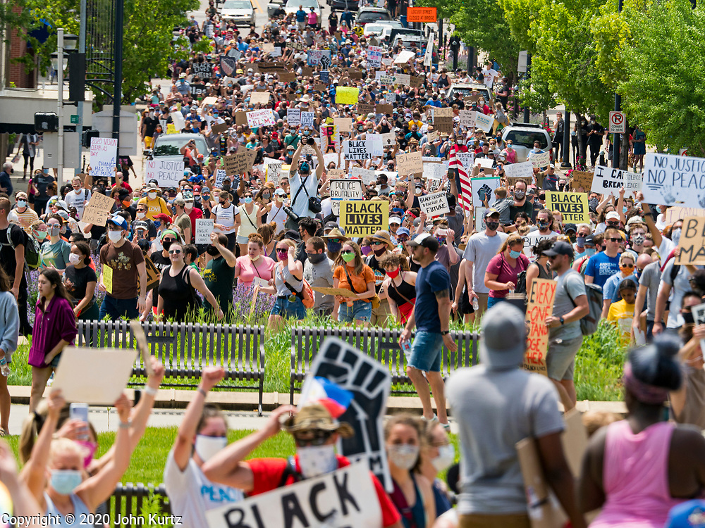 06 JUNE 2020 - DES MOINES, IOWA: People march up Locust Street towards the Iowa State Capitol during a Black Lives Matter march. More than 1,000 protesters marched through downtown Des Moines to the state capitol to demand an end to police violence against Black people. The march was organized by Black Lives Matter and honored George Floyd, the unarmed Black man killed by Minneapolis police on 25 May 2020.       PHOTO BY JACK KURTZ