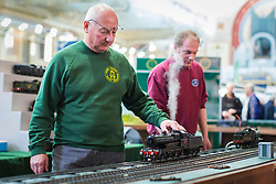 19/01/2018. London, UK. Members of the Gauge '1' Steam Locomotive Society tend to model trains at the London Model Engineering Exhibition at Alexandra Palace. Over 50 clubs and societies are exhibiting nearly 2,000 models constructed by their members. Photo credit: Rob Pinney