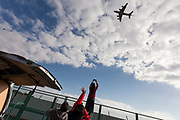 Japanese aircraft enthusiasts wave at a Kawasaki P1 Maritime patrol aircraft with the Japanese Maritime Self Defence Force (JMSDF) as it takes off from Naval Air Facility, Atsugi near Yamato, Kanagawa, Japan. Wednesday January 23rd 2019