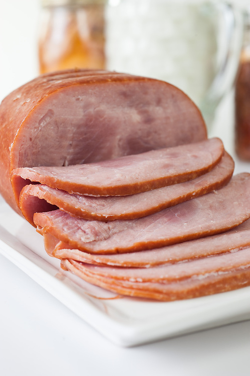 Sliced ham on a platter.