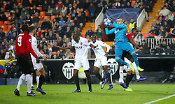 Manchester United's Eric Bailly clashes with Valencia goalkeeper Domenech Jaume